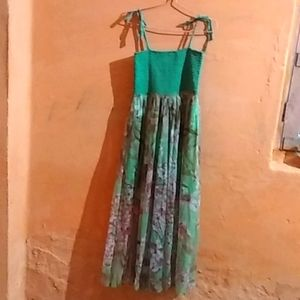 The green floral print  full dress and the size is M,L  and  the colour is light